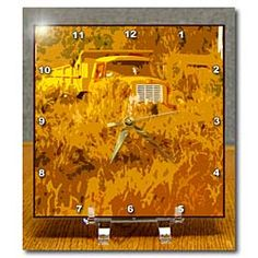 A truck with yellow hues in a bunch of weeds Desk Clock