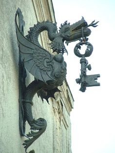 Dragon with key - Locksmith shop shingle, Hungary.