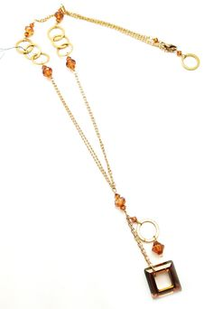 Necklace in circle and square drops playfully mingle on 17.5 inch 14k gold fill chain bedazzled with copper Swarovski crystals. 14k gold fill lobster clasp. Pair it with a beautiful dress and you're ready to go.  Handmade by myself, Stacee Gillelen.