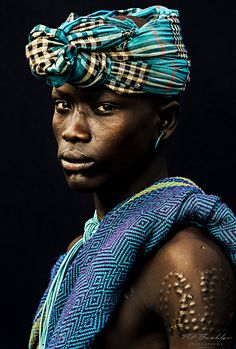 "Young Warrior from the Karo Tribe. Omo Valley // ©Pit Buehler from a series called ""African Vogue"" October We Are The World, My People, People Around The World, Population Du Monde, Black Is Beautiful, Beautiful People, Tribal People, African Tribes, Turbans"