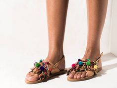 Kefi  Cotton colorful trims and fringes, semi-precious stones (agates and turquoise), multicolored pom poms, Preciosa and Swarovski crystals.  Get the experience: http://www.elinalinardaki.com/shoes/sandals/new-collection/sandal-kefi/