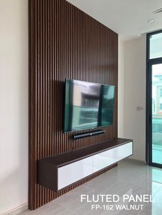 Create clean, crisp, continuous channels and shadow lines with Fluted Panel. This innovative and sophisticated product come in 3 different wood melamine finish (Oak, Walnut and Wenge ).Material made of WPC ( wood plastic composite ). Tv Feature Wall, Feature Wall Living Room, Feature Wall Design, Living Room Ideas Tv Wall, Lcd Wall Design, Tv Unit Decor, Tv Wall Decor, Tv Wand Design, Tv Wall Panel