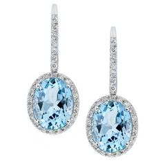 NATURAL BLUE TOPAZ DROP EARRINGS The Ravishing beauty of the Natural blue Topaz is contrasted with the 18K White Gold and Round Brilliant Cut diamonds, provoking a sense of elegance.
