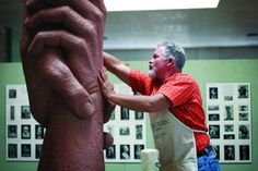 """Artist Gary Lee Price works on a prototype of """"The Statue of Responsibility.""""  - Kenneth Linge"""