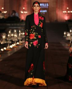 Black quilted angarkha style long jacket with embroidered rose motifs. Multicolor inner also included. Wash care: Dry clean only.Disclaimer: There might be a slight color variation in this item as this image is from the actual runway show. Rohit Bal, Indian Look, Jacket Brands, Long Jackets, Indian Designer Wear, Indian Fashion, New Dress, Formal Dresses, How To Wear