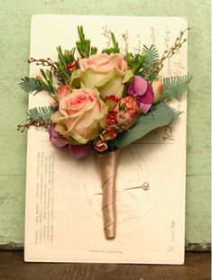 (via Interview with Vic Brotherson of Scarlet & Violet | Flowerona) I love this idea of pinning a corsage to vintage postcards.