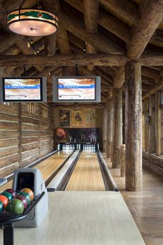 Here is a bowling lane inside a log home.