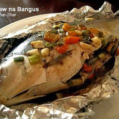Inihaw na Bangus  Grilled milkfish -- http://www.pinterest.com/ronleyba/filipino-recipes-philippine-foods-filipino-dish/