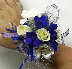 Royal Silver and White wrist corsage by Twigs Blue Corsage, Prom Corsage And Boutonniere, Corsage Wedding, Wrist Corsage, Boutonnieres, Homecoming Flowers, Prom Flowers, Wedding Flowers, Homecoming Corsage
