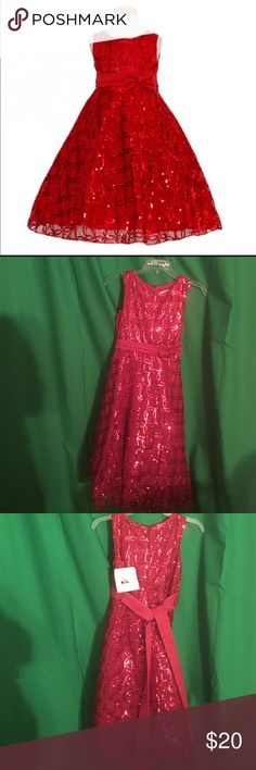 SUGARPLUM RED TULLE SEQUIN LITTLE GIRL DRESS A beautiful red sequin detailed dress for your little girl from Sugar Plum. Sleeveless dress possesses exquisite details of soft mesh overlay and red sequin detail. Red double pleated sash with darling bow just left of center at waistline ties in back for a perfect bow finish. This dress is perfect for a special holiday occasion or any fancy affair. Dresses Formal