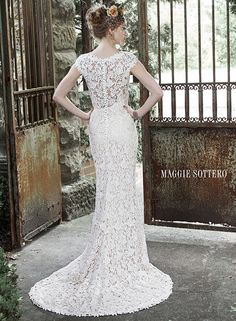 Elaborate patterned lace sheath wedding dress with stunning illusion lace back, romantic illusion sweetheart neckline and feminine cap-sleeves. Trudy by Maggie Sottero.