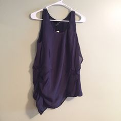 Asymmetric Blouse Dark blue draped, asymmetric sleeveless blouse. Side zipper. Size small, loose fitting; could fit a medium as well.  Please ask questions prior to purchase - all sales are final  • Bundle to save • Fast shipping • No trades / no holds  • Offer button only Sugar Lips Tops Tank Tops