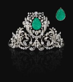 FROM THE COLLECTION OF A GERMAN PRINCESS EMERALD AND DIAMOND TIARA, 19TH CENTURY Composed of foliate, scroll and swag motifs set with cushion-shaped, circular-cut, oval and rose diamonds, claw-set with a carved emerald depicting the Madonna and Child to the front and the Annunciation to the reverse, inner circumference approximately 350mm, emerald possibly later set.