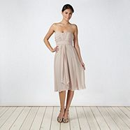 This light brown chiffon dress from Debut has a ruched bust with a bandeau neckline and a draped waterfall front. The bodice is fitted with detachable straps for a versatile look. Chiffon Dress, Strapless Dress, Brown Bridesmaid Dresses, Debenhams, Bodice, Dress Ideas, Shoulder Straps, Fashion, Chiffon Gown