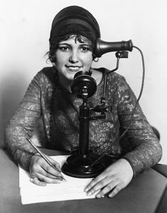 "multitasking in October 1927, using a ""Holdaphone"""
