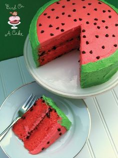 """Watermelon Flavored Cake Recipe ~ The delicious cake gets its flavoring from both watermelon puree and the icing is watermelon flavored, too! The inside layers are studded with chocolate chip """"seeds"""