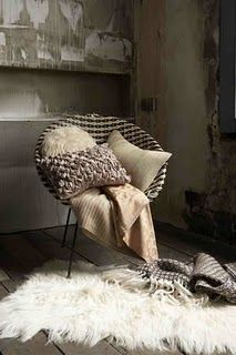 The fury textured rug gives warmth to this interior