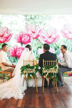 better together sweetheart chair signs and giant pink flower garden backdrop / http://www.himisspuff.com/wedding-chair-decor-ideas/9/