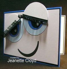 By Jeanette Cloyd. Use circle punches for eyes and mouth. For eyebrows, she used some she found at a garage sale. Could make some, though, with scissors and black paper. Such a cute card!