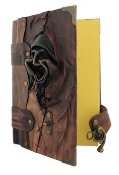 Hand made leather face on a hand made leather journal / notebook. This is so scary but cool!