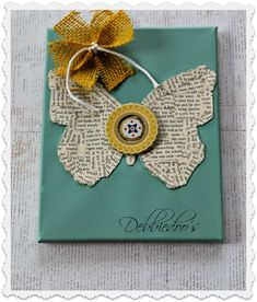 How to make your own canvas art,using mod podge, old book pages and a dollar tree butterfly. Easy and cute!