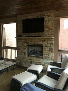 Screened porch with gas fireplace.
