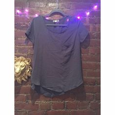 Gray blouse tee with pocket A cute tee shirt in a blouse material. Slight hi low. Urban Outfitters Tops