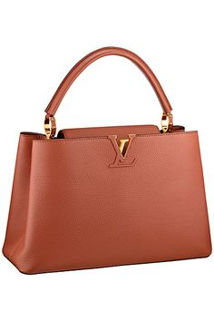Luis Vuitton, nice simple and sleek design. Would look nice in a deep navy or plum color