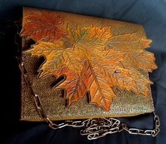 Hand tooled leather bag / purse / clutch with maple leaves and ladybug - original design