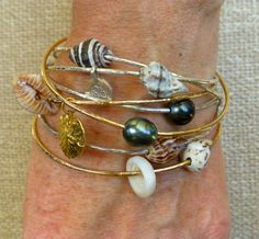 Wrist Candy for the Beach Lover!  Sterling Silver and Gold Bangles with Tahitian Pearls and Seashells from deva-designed.com.  #handmade jewelry