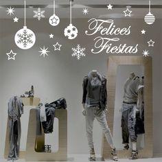 Vinilo navideño felices fiestas, con bolas colgando, estrellas y copos de nieve.