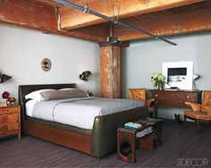 In the bedroom, Steven Volpe designed the sconces and bed, which is upholstered in a Rose Tarlow leather and dressed with Pratesi linens.
