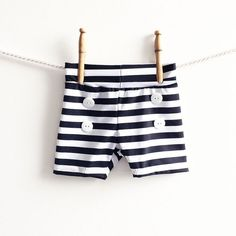 Baby Swim Trunks   Boys Black and White Shorts   Toddler Boy Bathing Suit   Swimwear Nautical Retro Lounge Shorts Shorties Boyshorts Swimmer ____________________________________________________________________________________  The story: Do you remember those totally retro swim trunks that were short and tight? I may not want my husband to wear them but on chubby, baby thighs... absolutely! Swap out the baggy surf shorts that come down to babys calves and grab little retro swim shorts that…