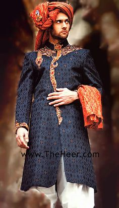 Navy sherwani with orange accents