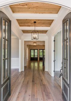 Wood ceilings in foyer and cornucopia room Really like the color of the floors. The ceiling is amazing. Love the lights and overall look of rooms Style At Home, Entry Way Design, Entrance Design, House Entrance, Farm Entrance, Entrance Foyer, Wood Ceilings, Wood Plank Ceiling, Coffered Ceilings