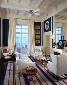 How dramatic are those drapes? Nothing beats a classic navy and cream color scheme.  It never looks dated.