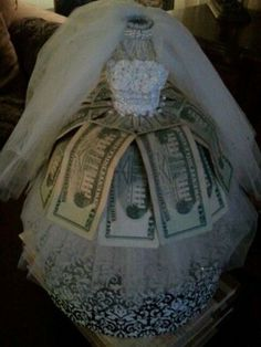 Bridal shower gift of money presented creatively. See more bridal shower gift ideas at www.one-stop-party-ideas.com