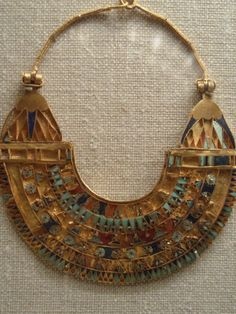 Ancient Egyptian neckpiece at the Metropolitan Museum of Art in New York.| 24 carat gold, turquoise, coral and enamel.