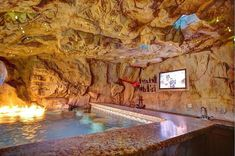 Rustic Swimming Pool with Indoor pool, Fire pit, Swim up bar, Ricorock Structural Grottos & Caves - Mini Cave, Grotto