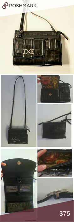 "Brighton Black Croco Leather Organizer Crossbody Croco Leather Small Organizer Purse Wallet  Front Has Hidden Zip Pocket 5x4 Wallet Opens to  3 Card Holders and Hidden Coin Compartment 4x2 Velcro Closure Cell Phone Pocket  Middle has a Full Top Zip Opens to Main Purse Compartment Lined in Floral Fabric  Back Has a Double Snap Closure and Opens to 2 Clear ID Holders 4 More Credit Card Holders  3 full size Bill Compartment Full Size Checkbook slot with Pen Holder  Approximately  5 x 5.5"" 3""…"
