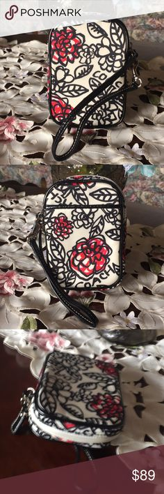 """Coach floral phone case Small,Color black,white/red/pink with silver tone hardware..in great condition..from smoke &pet free home..100% authentic..its a poppy collection...measurement:3 1/2""""(w)x5""""(H)x1""""D Coach Bags Clutches & Wristlets"""