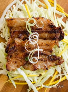 Miso Pork Belly marinade that makes pork belly extra tender and delicious. Serve green onions cabbage slaw and rice with gochujang sauce!