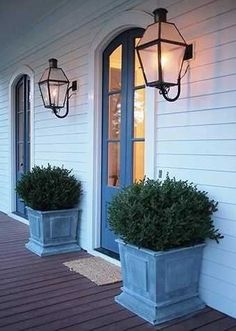 Charming entry way with planters and lanterns. Bevolo French Quarter Lantern with Gooseneck Bracket. love these planters! Front Door Overhang, Front Door Porch, Front Doors, Arched Doors, Front Entry, Sliding Doors, Gas Lanterns, Large Lanterns, Front Entrances
