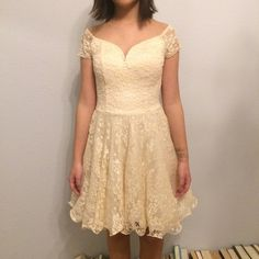 Cream Laced Over-the-Shoulder Dress Beautiful cream laced dress. Unused. Still has the tag. Built in padding. Side zipper. Great for high school dances! Chi Chi London Dresses Mini