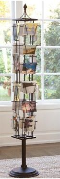 """I love the idea of using vintage postcards in a postcard carousel as a way for guests to """"sign the guestbook"""" and offer friendly advice about marriage and life. Guests would take a printed postcard from the carousel, write a message, and put the postcard in a vintage suitcase."""