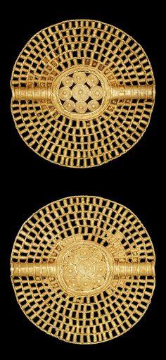 Africa   Lost wax casting in gold of a bi-facial open-work disc pendant (akrafokonmu).   Asante people. Ghana   ca. 1817 or earlier    {2.2}