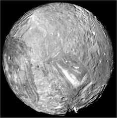 Verona Rupes, located on Uranus' moon Miranda, is the tallest cliff in the solar system.  Estimated to be 12 miles high (10 times the depth of the Earth's Grand Canyon).  How the giant cliff was created remains unknown, but is possibly related to a large impact or tectonic surface motion.