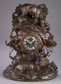 An Antique Black Forest Carved Walnut Mantel Clock, the crest carved with deer and bocage on rockwork, central dial over an Unusual Clocks, Cool Clocks, Black Forest Wood, Mantel Clocks, Retro Clock, Mexican Designs, Grandfather Clock, Wooden Clock, Antique Clocks