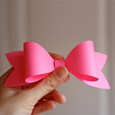 Learn how to make an easy paper bow. Cute on packages and gifts!