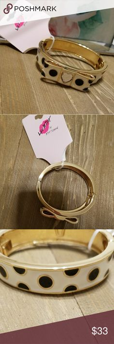 NWT- BETSEY JOHNSON BOW BRACELET NWT- BETSEY JOHNSON BLACK & WHITE POKADOTS BOW HEART SHAPE DIAMOND PENDANT BRACELET. THIS BEAUTIFUL PIECE WILL PAIR WELL WITH ANY OUTFIT YOU WILL NOT BE DISAPPOINTED WITH THIS BRACELET GRAB YOURS TODAY LIMITED AMOUNTS AVAILABLE.  NWT-BRAND NEW WITH TAGS 100% AUTHENTIC NO TRADES OFFERS ACCEPTED THROUGH THE OFFER BUTTON  PLEASE FOLLOW CLOSET RULES! I DO NOT TOLERATE RUDE BEHAVIOR! Betsey Johnson Jewelry Bracelets